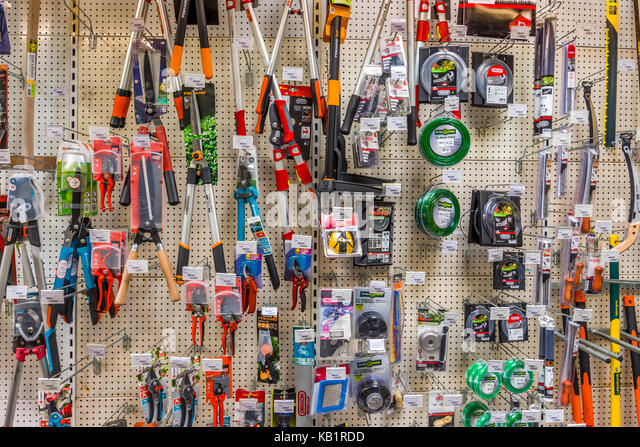Display of gardening tools in garden shop - France. - Stock Image