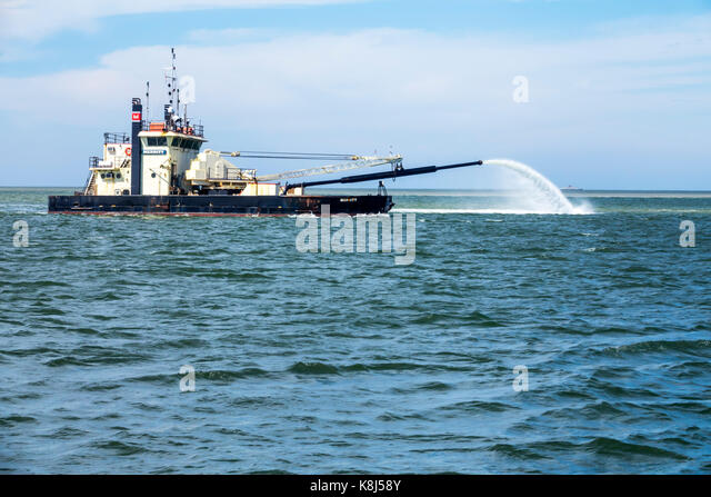 North Carolina NC Outer Banks Ocracoke Island Pamlico Sound dredging sidecast dredge boat Army Corps of Engineers - Stock Image