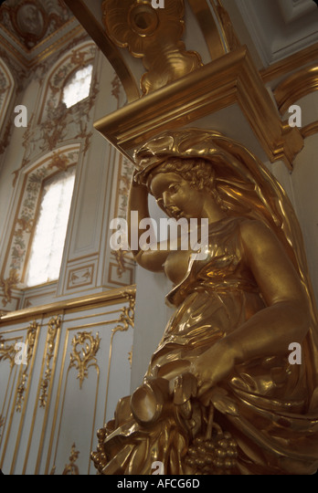 Russia former Soviet Union Peterhoff Petrodvorets Peter the Great Summer Palace gilded stucco near ceremonial staircase - Stock Image