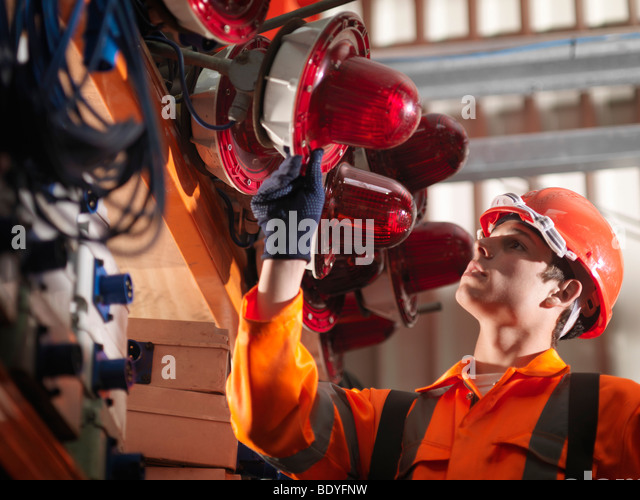 Crane Worker Checking Safety Lights - Stock Image