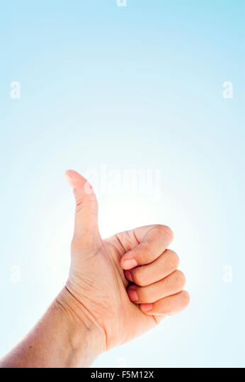 Sweden, Uppland, Varmdo, Hand showing thumbs up - Stock Image