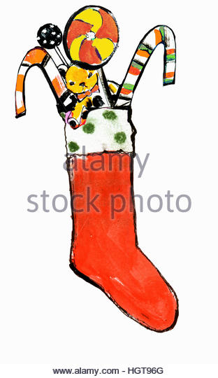 Christmas stocking filled with teddy bear and candy canes - Stock-Bilder