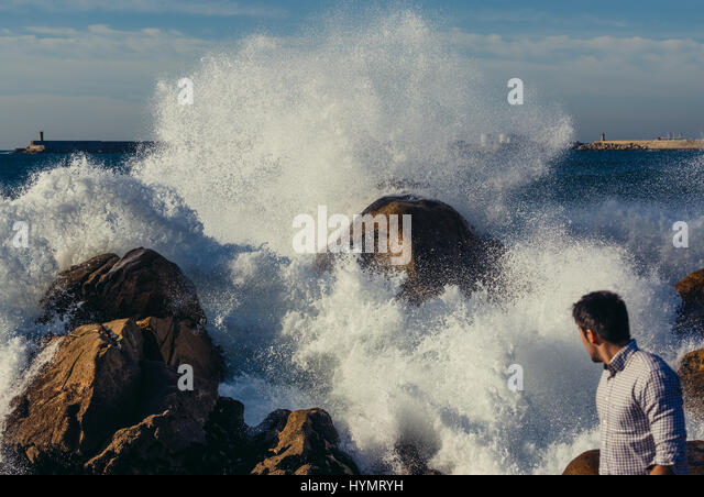 Big waves smashing on rocks of Atlantic Ocean shore in Nevogilde civil parish of Porto, second largest city in Portugal - Stock Image