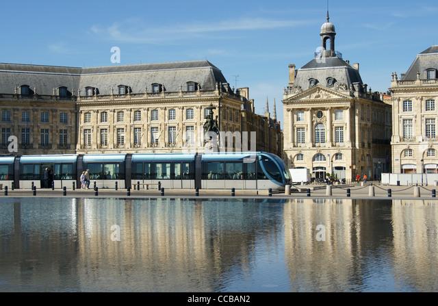 Tram by Miroir d'Eau, Place de la Bourse, Bordeaux, France - Stock Image