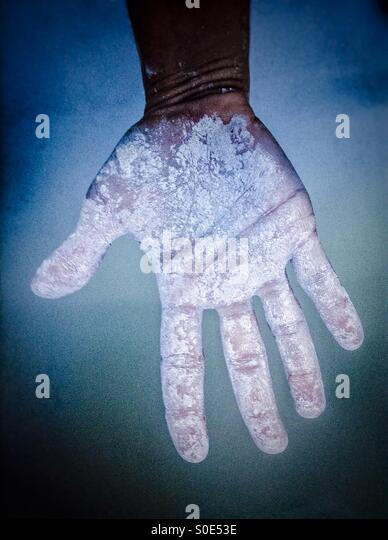 Down colorful hand dirty with gluten free flour - Stock Image