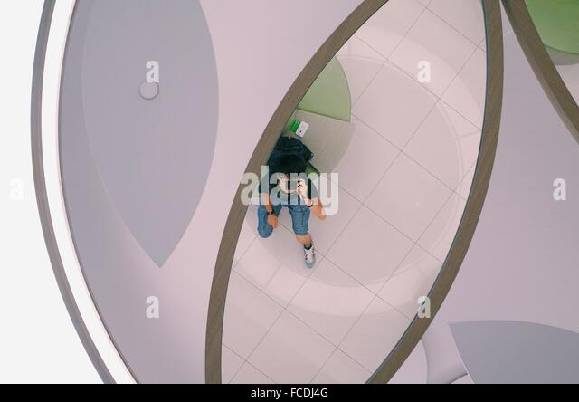 Directly Below Shot Of Young Man Photographing - Stock Image