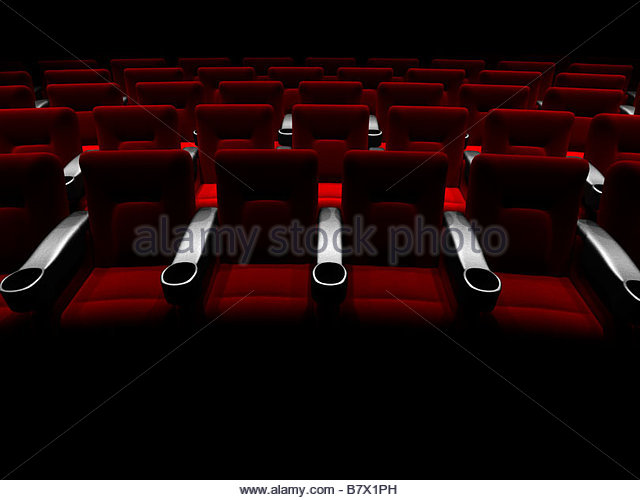 Rows of theatre or cinema seats seen from the front - Stock Image