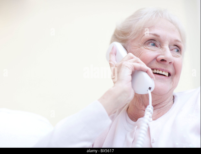 Senior woman talking on the telephone - Stock Image