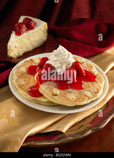 Strawberry cheese cake pancakes with whipped cream - Stock Image