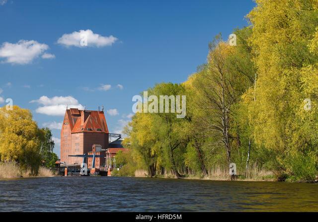 Storage building at harbour, River Peene, Hanseatic city of Demmin, Peenetal Nature Park, Mecklenburg-Western Pomerania, - Stock Image