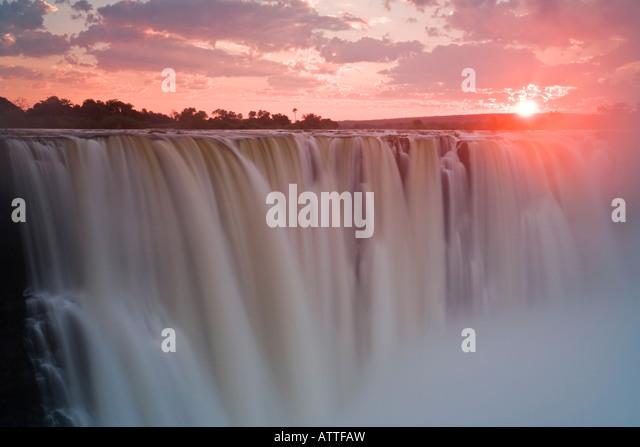 Evocative sunrise over Victoria Falls (Mosi-oa-Tunya), Zimbabwe - Stock Image
