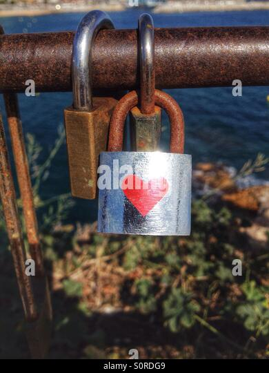 Lock with red heart on a bridge - Stock-Bilder