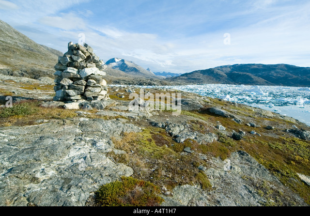 Cairn at the abandoned Inuit settlement of Paornakajît, Sermilik Fjord, East Greenland - Stock Image