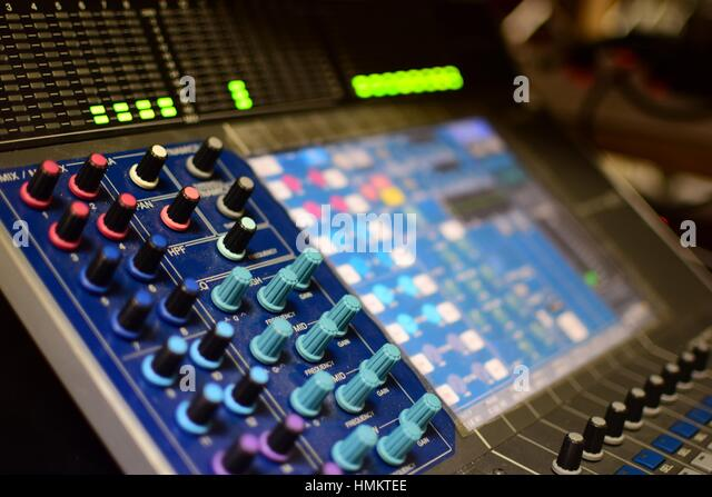 Shallow Depth-of-field Generic Photo of Concert Music Broadcast Soundboard Mixer and Equalizer with Knobs and Audio - Stock-Bilder