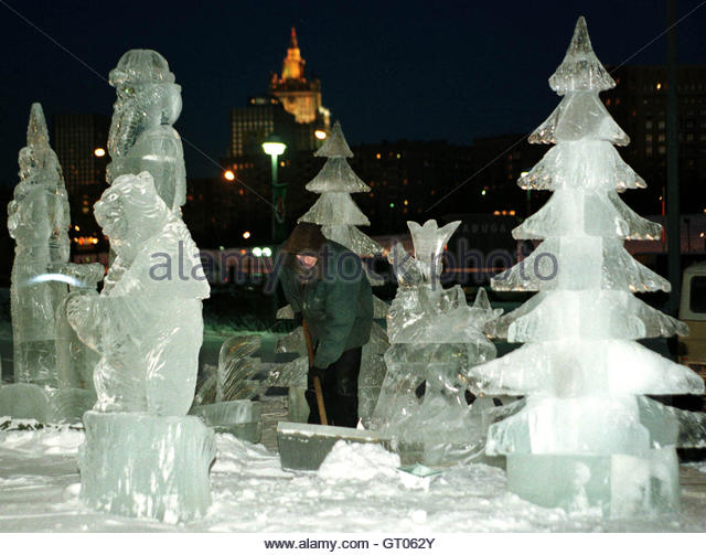 A worker removes snow among Christmas ice sculptures December 14. The temperature in the Russian capital today lowered - Stock Image