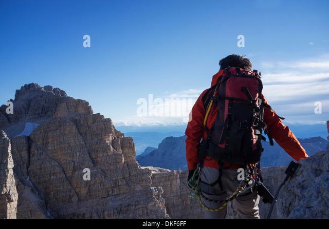 Climber in Brenta Dolomites, Italy, preparing for climb - Stock Image