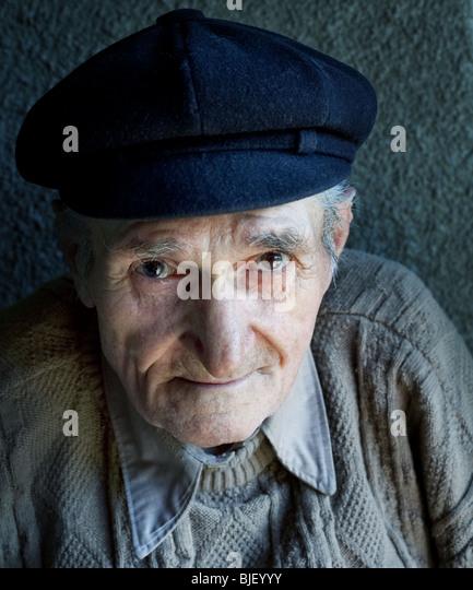 Portrait of friendly senior man - Stock Image
