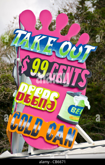 Purple sign for take out beer cheap price St Maarten Philipsburg Front Street - Stock Image
