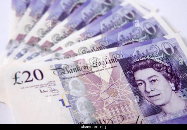 'twenty pounds' note 'twenty pound' notes money sterling currency bundle stack - Stock Image
