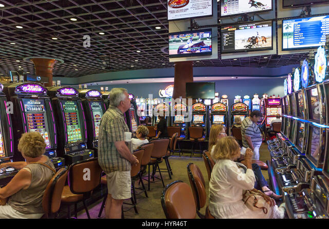 HALLANDALE BEACH, USA - MAR 11, 2017: People gambling at the slot machines at Gulfstream park casino in Hallandale - Stock Image