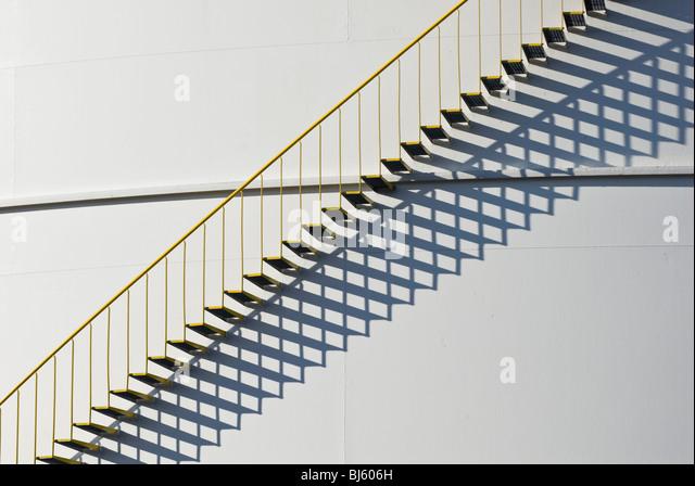 Detail of industrial storage tank with metal stairway - Stock Image