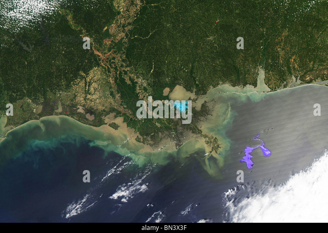 Satellite image of a massive oil slick in the Gulf of Mexico on April 29, 2010, spreading and moving perilously - Stock Image