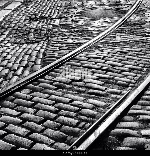 Old cobblestoned street with historic train tracks showing in the DUMBO neighborhood of Brooklyn, New York. - Stock Image