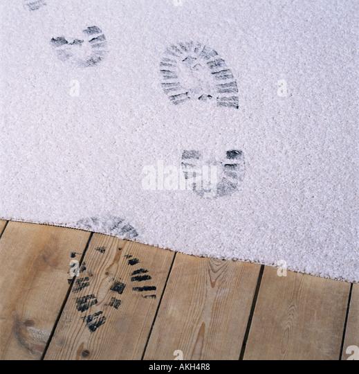 Black footprints on a carpet - Stock-Bilder