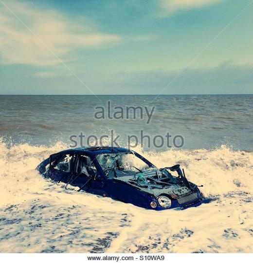 Abandoned Car in the Sea - Stock Image