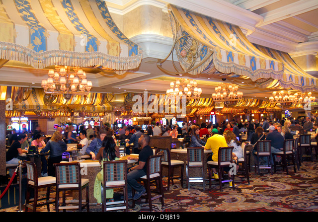 Nevada Las Vegas The Strip South Las Vegas Boulevard Bellagio hotel casino lobby gambling gamblers players tables - Stock Image