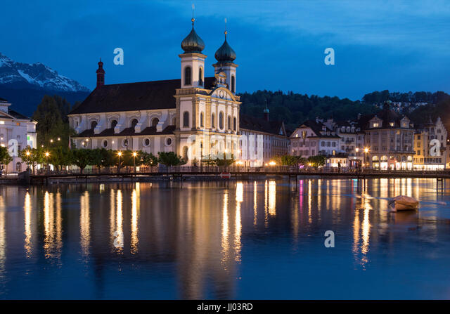 Dusk at the Jesuit Church by the River Reuss in the city of Lucerne (Luzern) in Switzerland. This Baroque church - Stock Image
