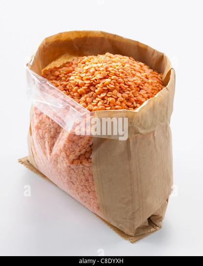 Bag of orange lentils - Stock Image