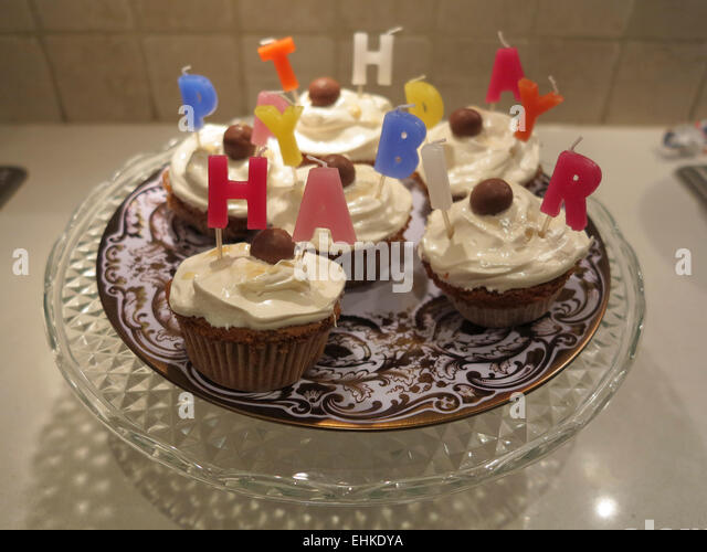 A Happy Birthday Cake Made Up Of Cup Cakes Candles And Chocolate On Stock Photo 79718670