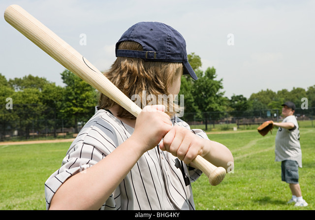 Father and son playing baseball - Stock Image