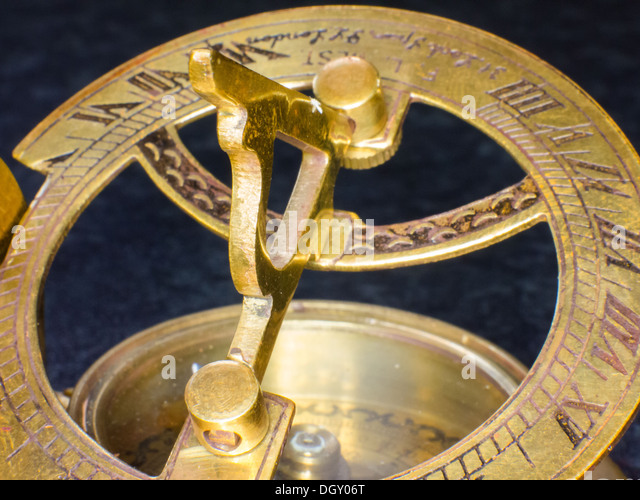 Old copper sextant and compass - Stock Image