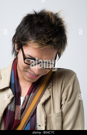 Shy young japanese man - Stock Image