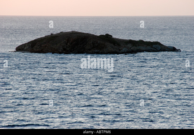 St. Thomas USVI Caribbean Sea rocky small uninhabited island - Stock Image