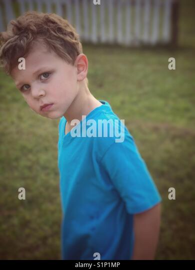 Boy with serious look - Stock Image
