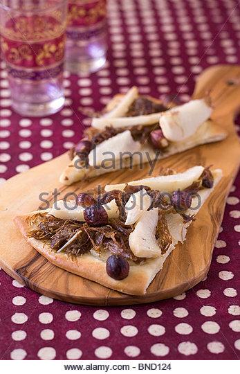 Duck confit pear pizzettes - Stock Image