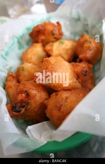 a basket of conch fritters, popular Bahamian cuisine, fried conch, Bahamas - Stock Image
