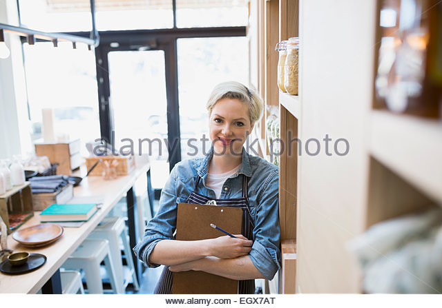 Portrait of confident market owner with clipboard - Stock Image