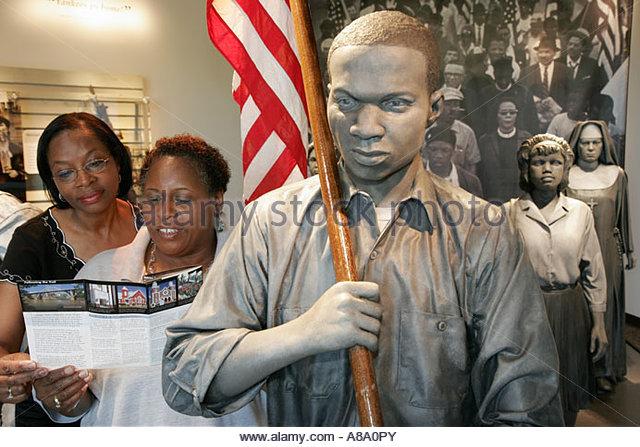 Alabama Highway 80 Selma Montgomery Civil RightsTrail Lowndes Interpretive Center exhibit Black female brochure - Stock Image