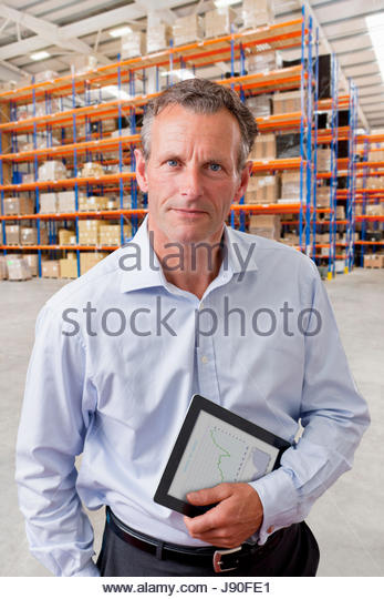Portrait Of Businessman With Digital Tablet In Warehouse - Stock-Bilder