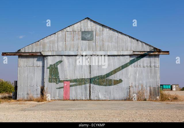 Abandoned hanger with glider logo, Kingsfield, Dhekelia, Cyprus. - Stock Image