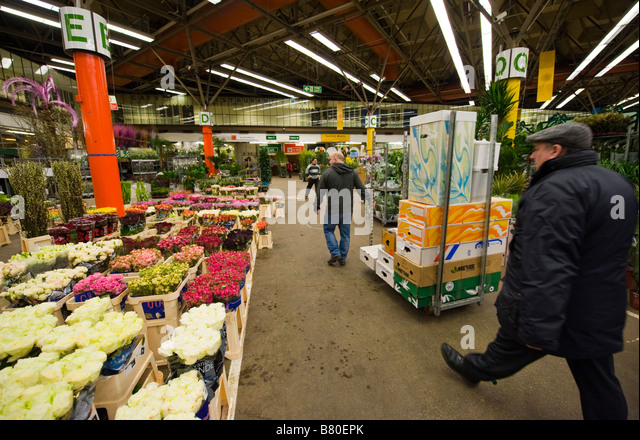 Customers and workers at the New Covent Garden Flower Market London UK - Stock Image