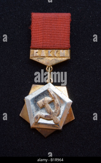 corroded Lenin's komsomol insignia on black - Stock Image