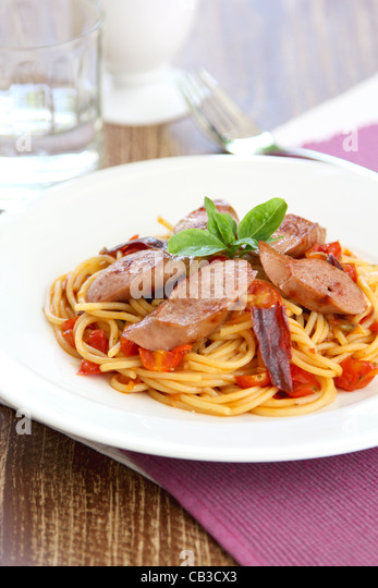 Pasta with sausage and tomato - Stock Image