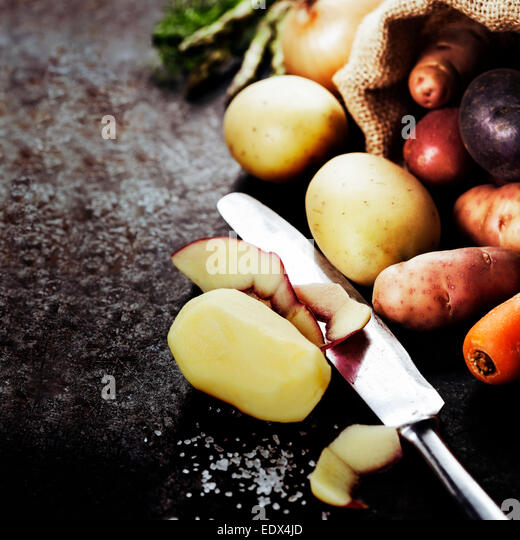 Fresh vegetables (potato, onion, carrot) ready for cooking. Health, vegetarian food or cooking concept. Fresh organic - Stock Image