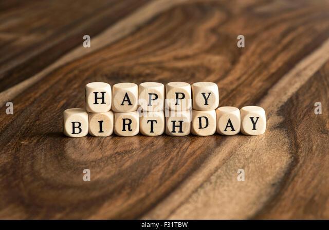 HAPPY BIRTHDAY word background on wood blocks - Stock Image