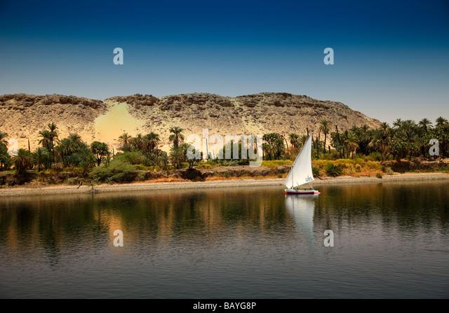 Felucca Sailing Boat on the River Nile near Aswan, Egypt - Stock Image